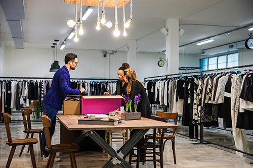 new-business-clothing-store,-team-at-work-on-new-arrivals